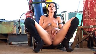 Cindy Hope in fishnet dress fingers her wet pussy outdoors
