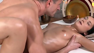 Masseur massaging brunettes pussy from inside
