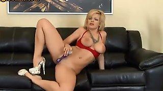 Blonde Milf porn star using a big dildo