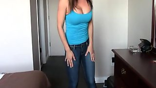 Asian Jasmine wetting her jeans pissing herself