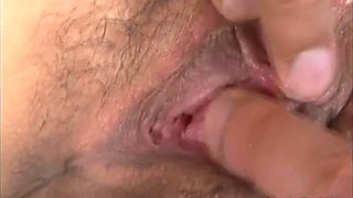 Nasty Asian porn chick enjoys sucking two hard cocks and double penetration