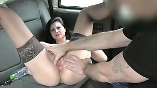 Brunette amateur enjoys anal sex in a fake taxi