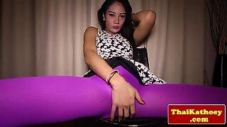 Thai ladyboy rubs her asshole in sensual striptease