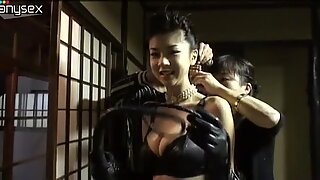 Naughty jap mistress Aki Hoshino boasts off her leather outfit